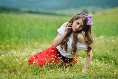 Beautiful smiling girl on cereal field in spring Royalty Free Stock Images