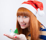 Beautiful smiling girl with a Christmas tree Royalty Free Stock Image