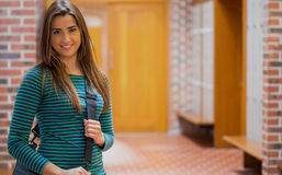 Beautiful smiling girl in college corridor Royalty Free Stock Image
