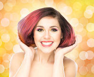 Beautiful smiling girl with colorful make-up Royalty Free Stock Image