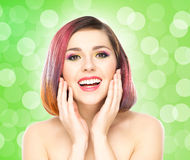 Beautiful smiling girl with colorful make-up Royalty Free Stock Photo