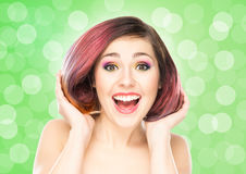 Beautiful smiling girl with colorful make-up Stock Photos