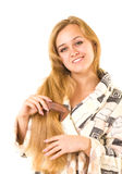 Beautiful smiling girl with comb Royalty Free Stock Images