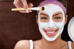 Beautiful smiling girl with cosmetic mask Royalty Free Stock Photography