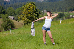 Beautiful smiling girl in country style dress. Posing at grass meadow Royalty Free Stock Photography