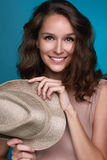 Beautiful smiling girl with dark curly hair holding straw Royalty Free Stock Photo