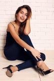 Beautiful smiling girl with dark hair and perfect skin posing in studio Stock Image