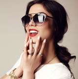 Beautiful smiling girl with dark hair with sunglasses and bijou Stock Photo