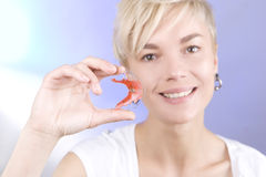 Beautiful smiling girl with dental retainer for teeth Stock Photography