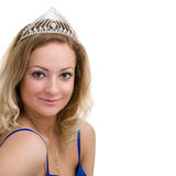 Beautiful smiling girl with diadem on a white Royalty Free Stock Images