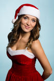 Beautiful smiling girl dressed as Santa Claus Stock Images