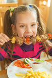 Beautiful smiling girl eating kebab Stock Images