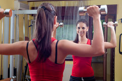 Beautiful smiling girl exercising with dumbbells Royalty Free Stock Image