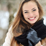 Beautiful smiling girl face outdoor winter portrait.  Stock Image