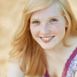 Beautiful smiling girl face portrait close up. Outdoors Royalty Free Stock Images