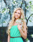 Beautiful smiling girl. In flowering garden Royalty Free Stock Photography