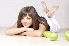 Beautiful smiling girl with green apples Stock Photo
