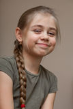Beautiful smiling girl, hair braided. Portrait of the smiling young girl Royalty Free Stock Image