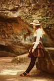 Beautiful girl in a hat in a vintage dress. Summertime park in mountains. Lolita style royalty free stock images