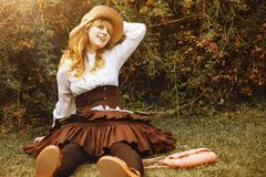 Beautiful smiling girl in a hat in a vintage dress. Summertime park. Lolita style royalty free stock photos
