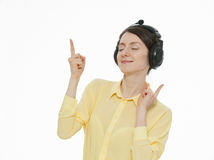 Beautiful smiling girl with headphones. Neutral background Stock Images