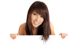Beautiful smiling girl holding a blank billboard. Royalty Free Stock Photo