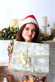 Beautiful smiling girl holding a box with christmas gift Stock Images