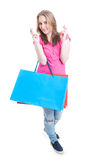 Beautiful smiling girl holding paper bags and wishing good luck Royalty Free Stock Images
