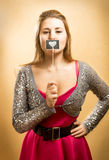 Beautiful smiling girl holding sign with drawn heart at lips Royalty Free Stock Photography
