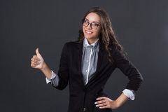 Beautiful smiling girl holding thumb up Stock Photo