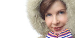 Beautiful smiling girl in a hood and gloves. On a white background Royalty Free Stock Photo