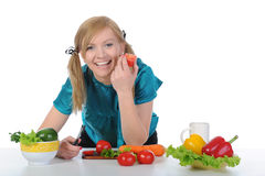 Beautiful smiling girl in the kitchen. Royalty Free Stock Image