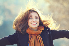 Beautiful smiling girl with long hairs in motion Royalty Free Stock Image