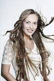 Beautiful smiling girl with long wonderful hair Royalty Free Stock Photography