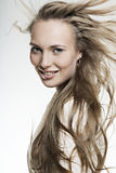 Beautiful smiling girl with long wonderful hair Stock Photography