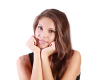 Beautiful smiling girl looks at camera and backs chin by arms Stock Photography
