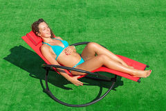 Beautiful smiling girl lying in a deck chair Royalty Free Stock Photography