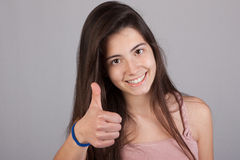 Beautiful smiling girl making ok sign Royalty Free Stock Photos