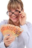 Beautiful smiling girl with money. Stock Photography
