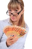 Beautiful smiling girl with money. Stock Images