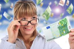 Beautiful smiling girl with money. Falling euro money on the background Stock Images