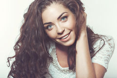 Beautiful smiling girl with natural makeup and loose hair. Royalty Free Stock Photo
