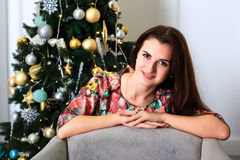 Beautiful smiling girl near a christmas tree Royalty Free Stock Photography