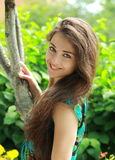 Beautiful smiling girl near tree Stock Photos
