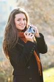 Beautiful smiling girl with old camera in hand Royalty Free Stock Photography