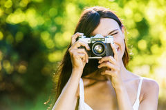Beautiful smiling girl with old camera Royalty Free Stock Image