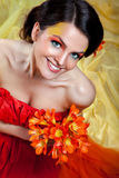 Beautiful smiling girl with orange flower Royalty Free Stock Photography