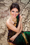 Beautiful smiling girl with oriental make-up and indian sari. Beautiful girl with oriental make-up, indian sari and indian jewelry Stock Images