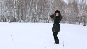 Beautiful smiling girl outdoors in winter stock video