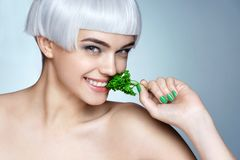 Beautiful smiling girl with parsley. Stock Image